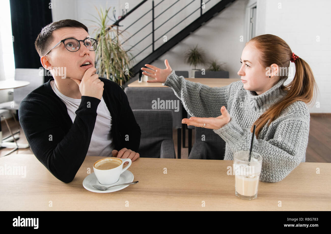 Young couple arguing in a cafe. Relationship problems - Stock Image