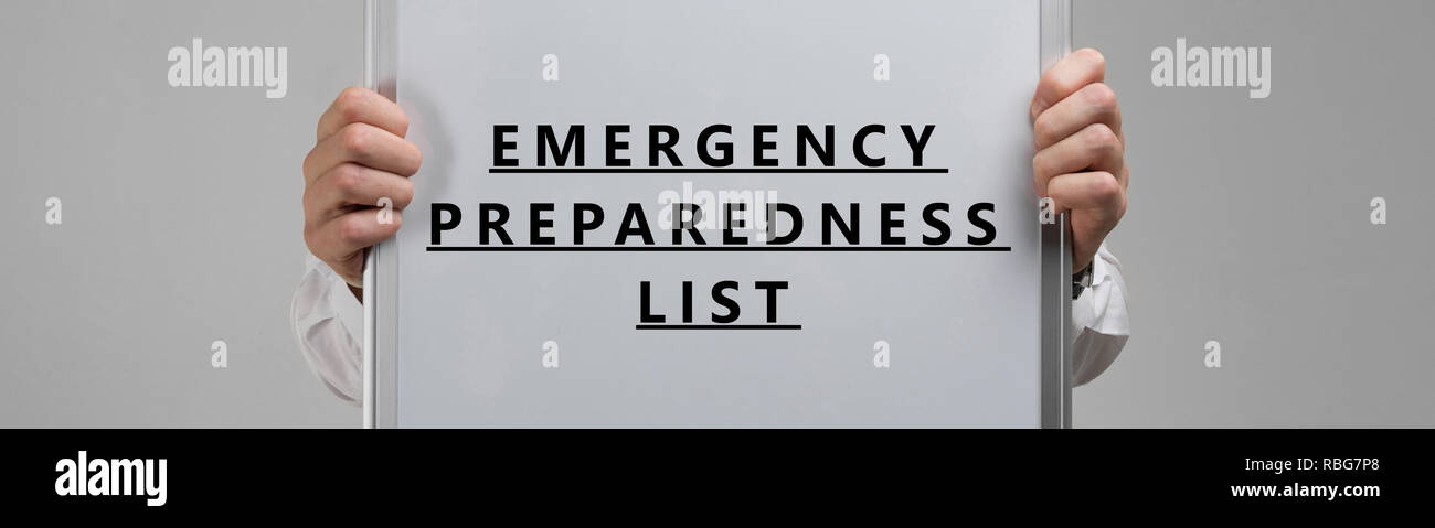 men's hands holding a poster with the inscription list of Emergency preparedness isolated on a light background - Stock Image