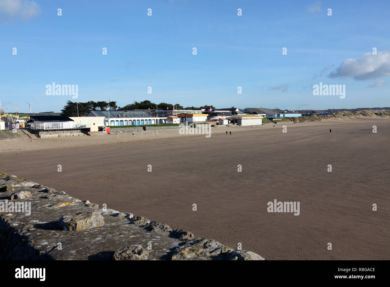Sand Bay at Porthcawl on a sunny winters day with everyone out for a walk along the promenade beside the seaside in this popular seaside town. - Stock Image