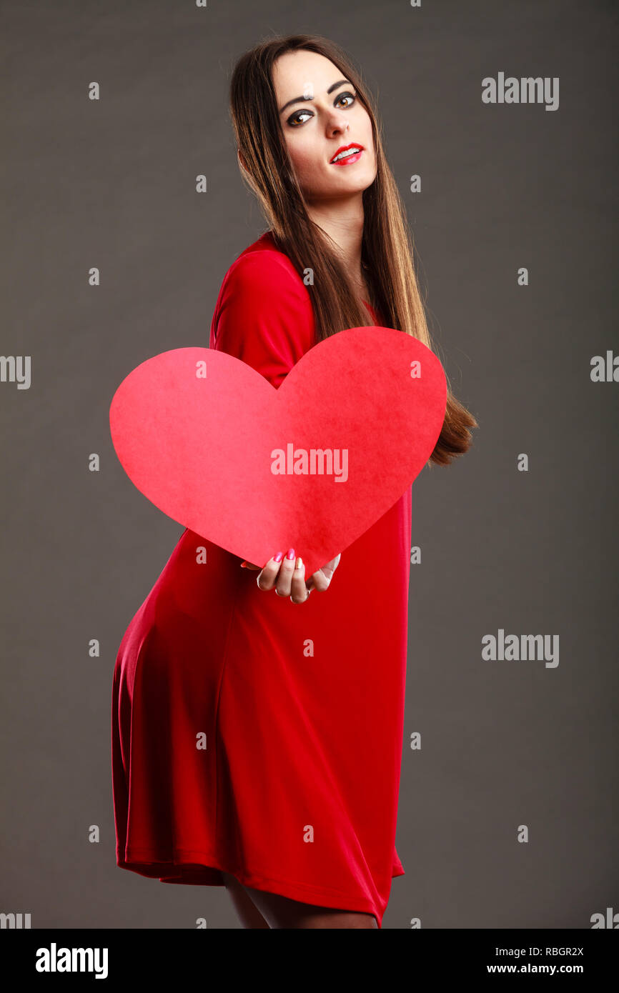 Valentines Day Love And Relationships Concept Brunette Woman Long Hair Girl In Red Outfit Holding Heart Love Symbol Dark Gray Background Stock Photo Alamy
