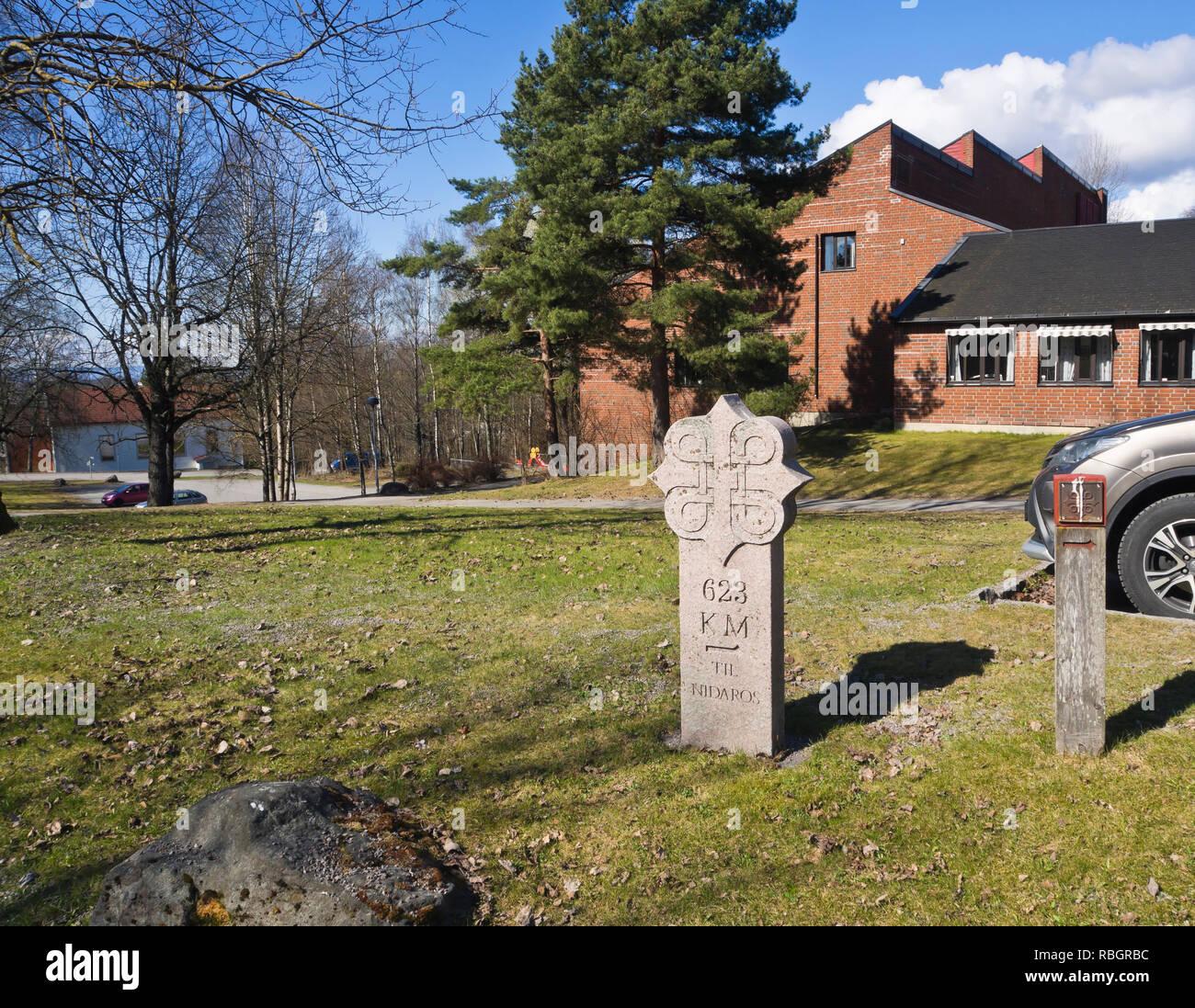Modern milestone in granite signposting the popular pilgrimage route to Trondheim and Nidaros set up in the Furuset suburb in Oslo Norway - Stock Image