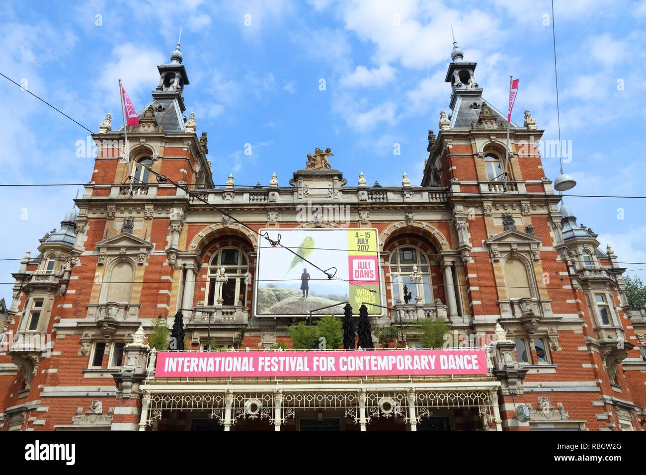 AMSTERDAM, NETHERLANDS - JULY 8, 2017: Stadsschouwburg theatre at Leidseplein in Amsterdam. The neo-Renaissance style building dates back to 1894. - Stock Image