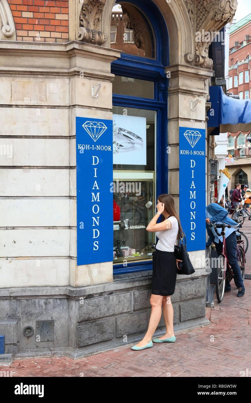 AMSTERDAM, NETHERLANDS - JULY 8, 2017: Tourist visits diamond factory shop Koh-i-noor in Amsterdam, Netherlands. Amsterdam has a long history of diamo - Stock Image