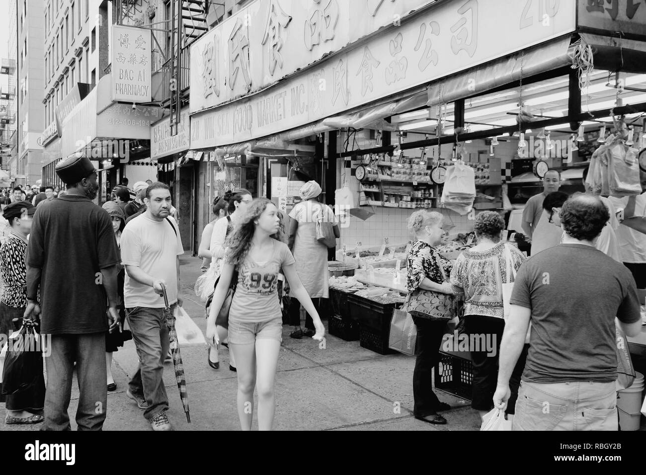 NEW YORK, USA - JULY 1, 2013: People shop in Chinatown in New York. NYC Chinatown has an estimated population of 100,000 people and is one of oldest C - Stock Image