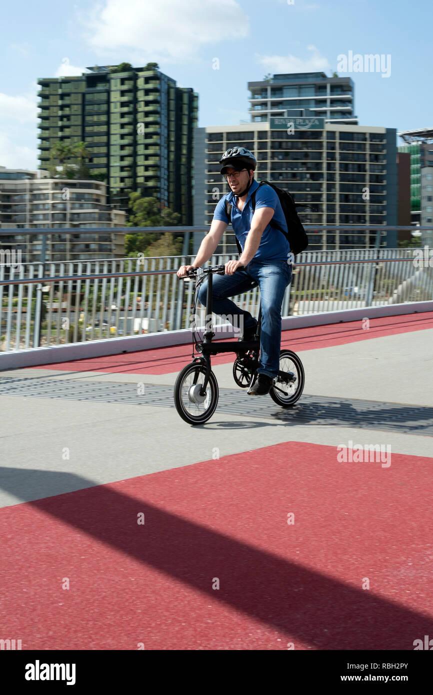 Cyclist crossing Goodwill Bridge, Brisbane, Queensland, Australia - Stock Image
