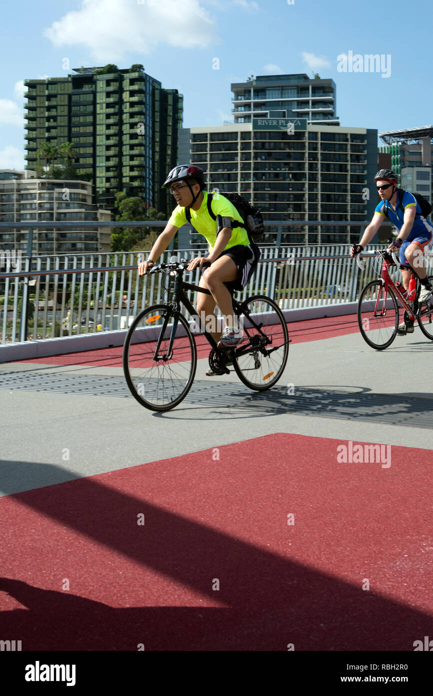 Cyclists crossing Goodwill Bridge, Brisbane, Queensland, Australia - Stock Image