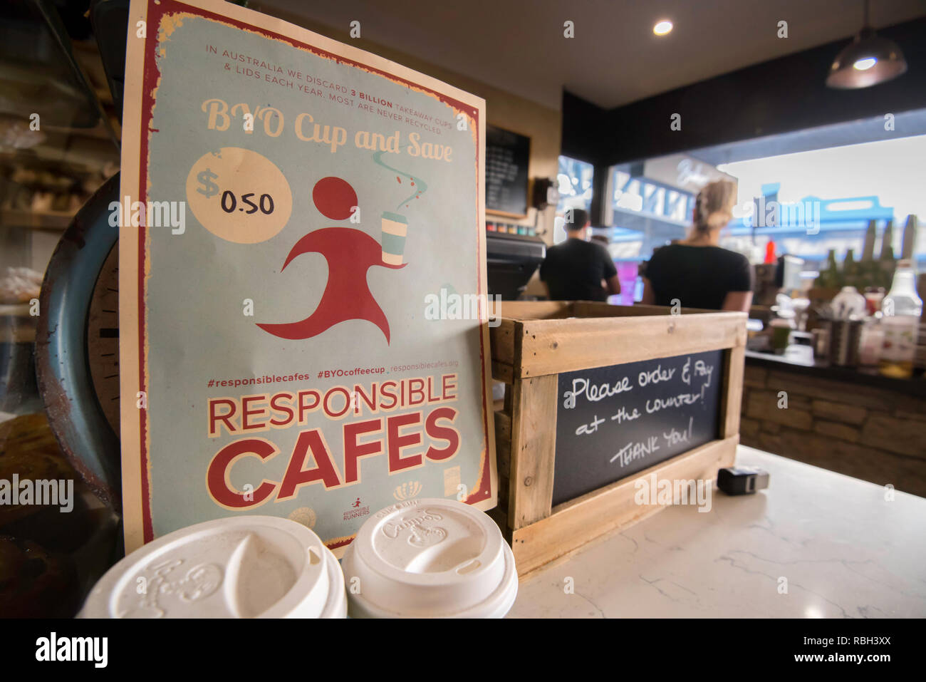 A sign in a northern Sydney cafe offering discounts for bring your own (BYO) cup coffee drinkers. Responsible Cafes reducing waste and pollution. - Stock Image