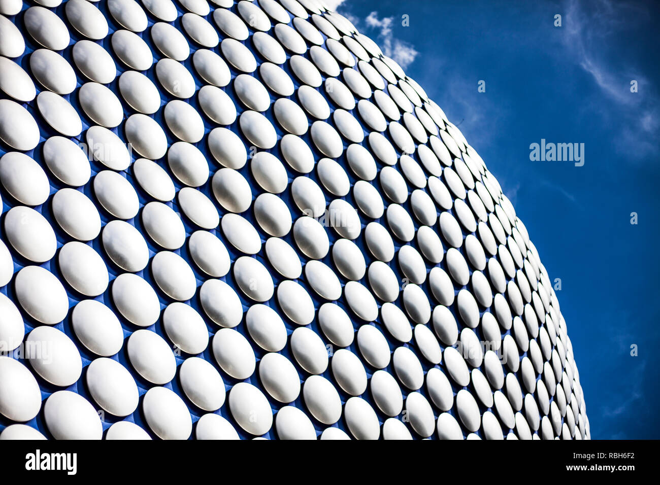 Futuristic modern building exterior cladding at the shopping mall in the centre of Birmingham, England. Blue pins of patern shown in the building. Mod - Stock Image