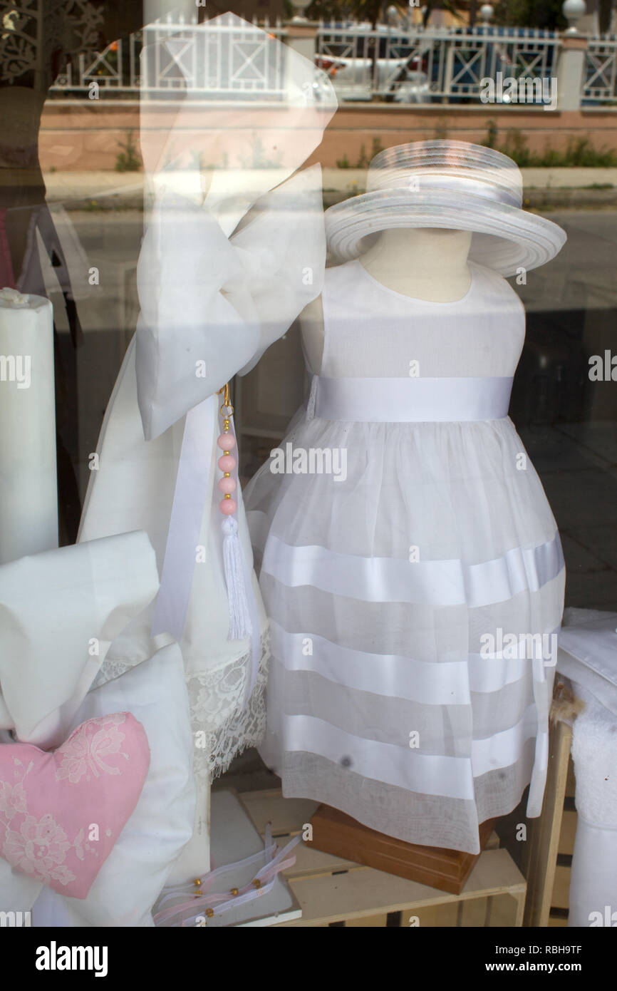 Girls Cocktail Dress Worn by No Head Mannequin on Display Window. Kids Formal Wear and Accessories on Special Occasions. Clothing Business eCommerce I Stock Photo