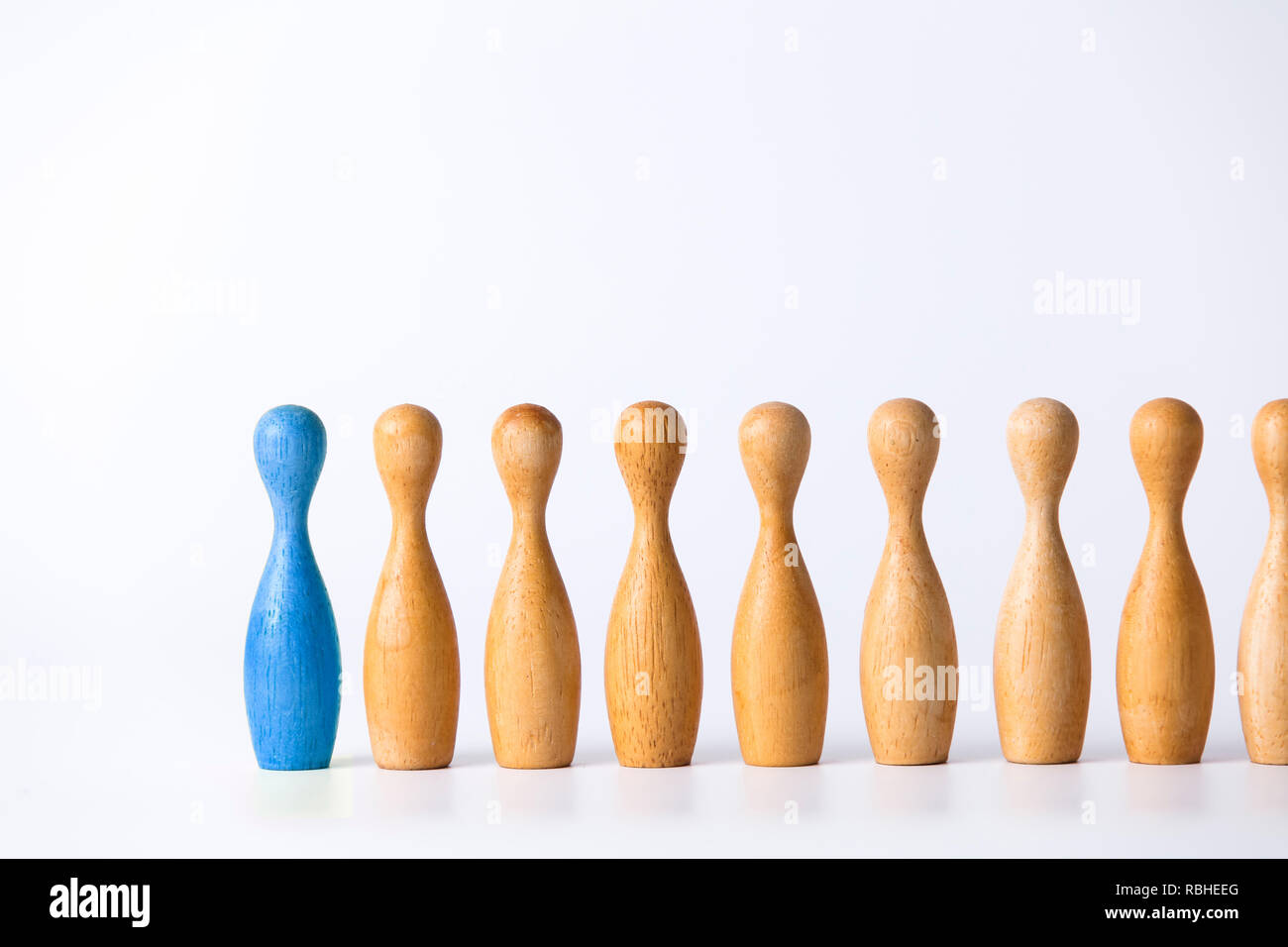 wooden figure stands out from the crowd. Business leadership concept - Stock Image