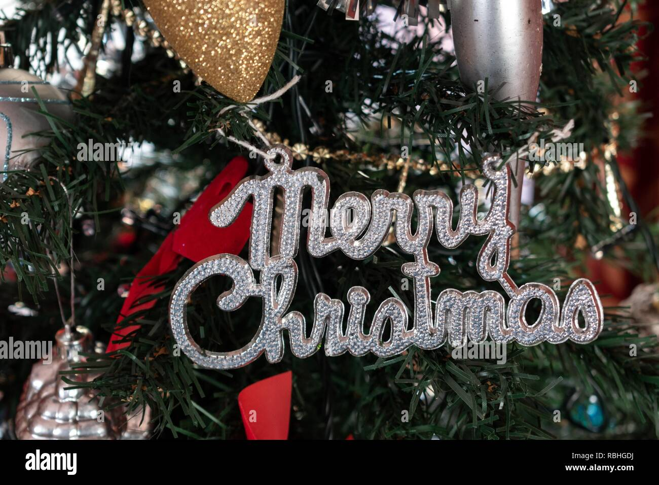 Merry Christmas Ornament Sign.Merry Christmas Hanging Sign On A Christmas Tree Stock Photo