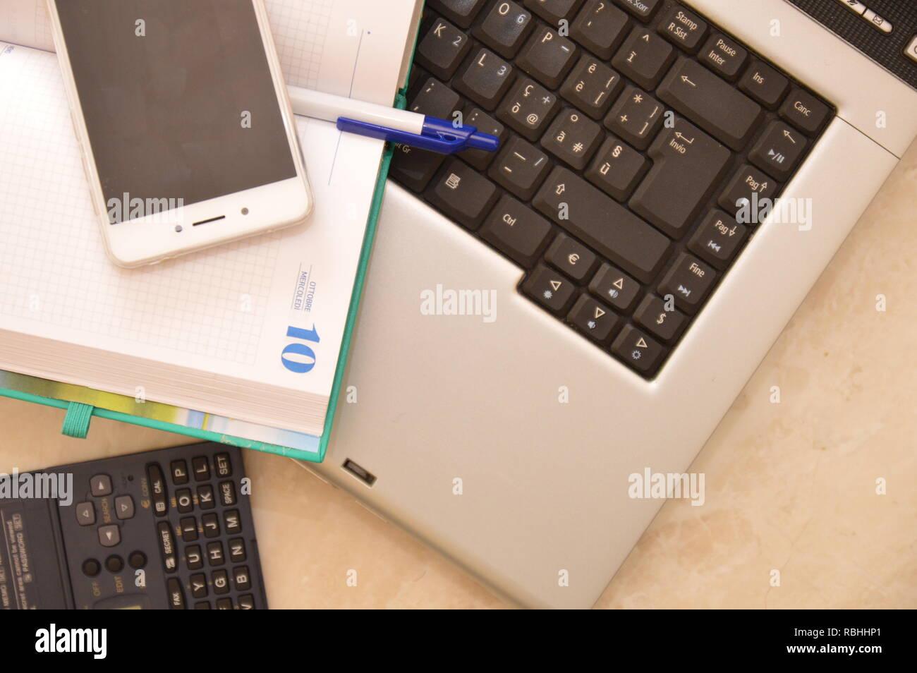 notebbok telephon pen work business calcilator - Stock Image
