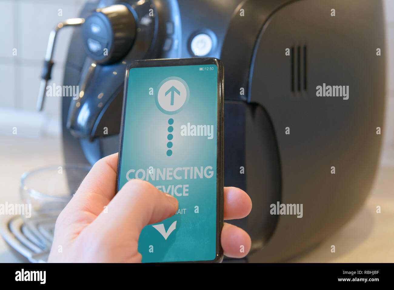 Connecting coffee machine with smart phone. Smart home and Internet of Things IoT concept - Stock Image
