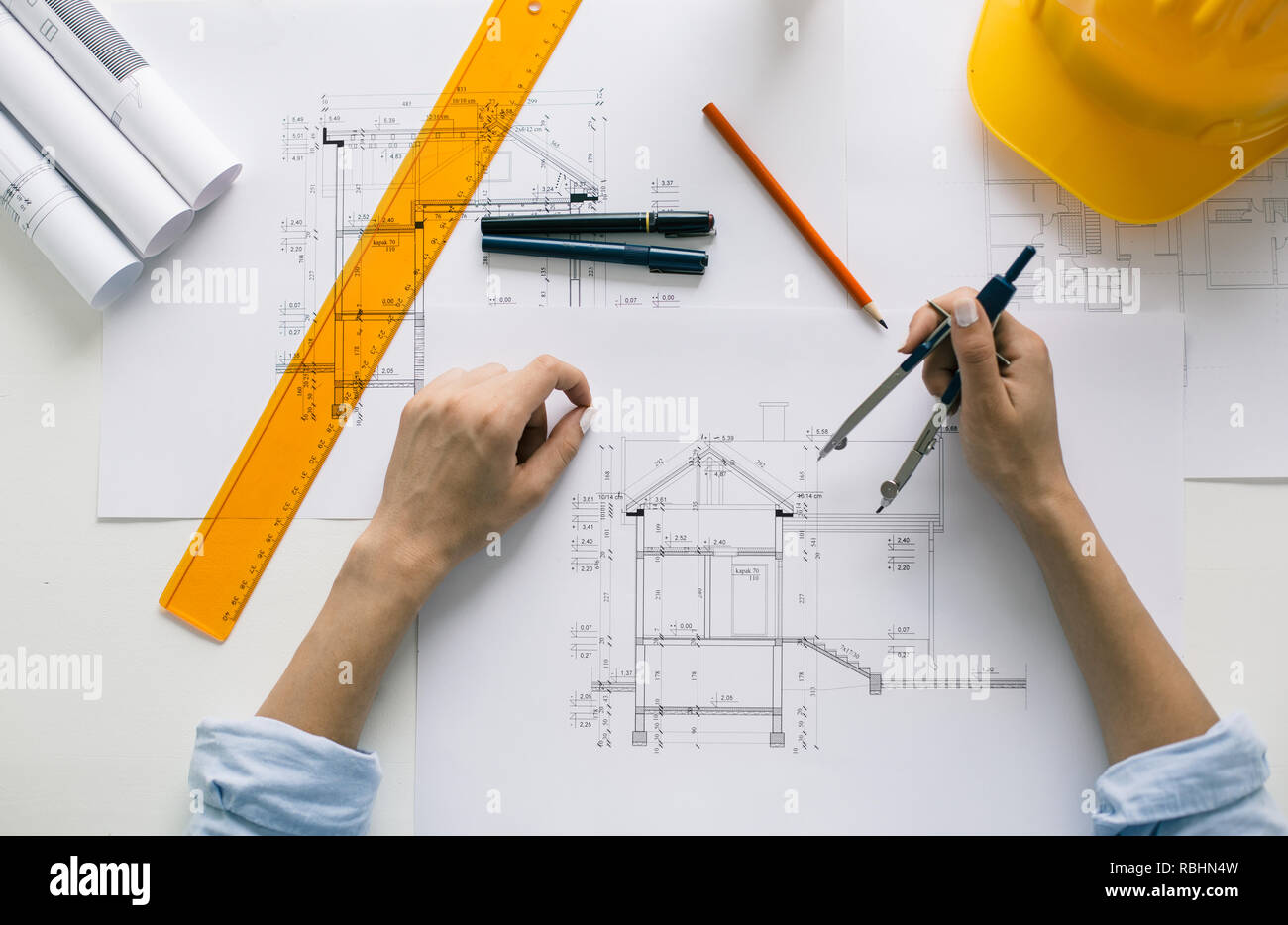 [SCHEMATICS_4PO]  High angle view of architect drawing blueprints. Architectural/engineering  project concept Stock Photo - Alamy | Architectural Engineering Schematics |  | Alamy