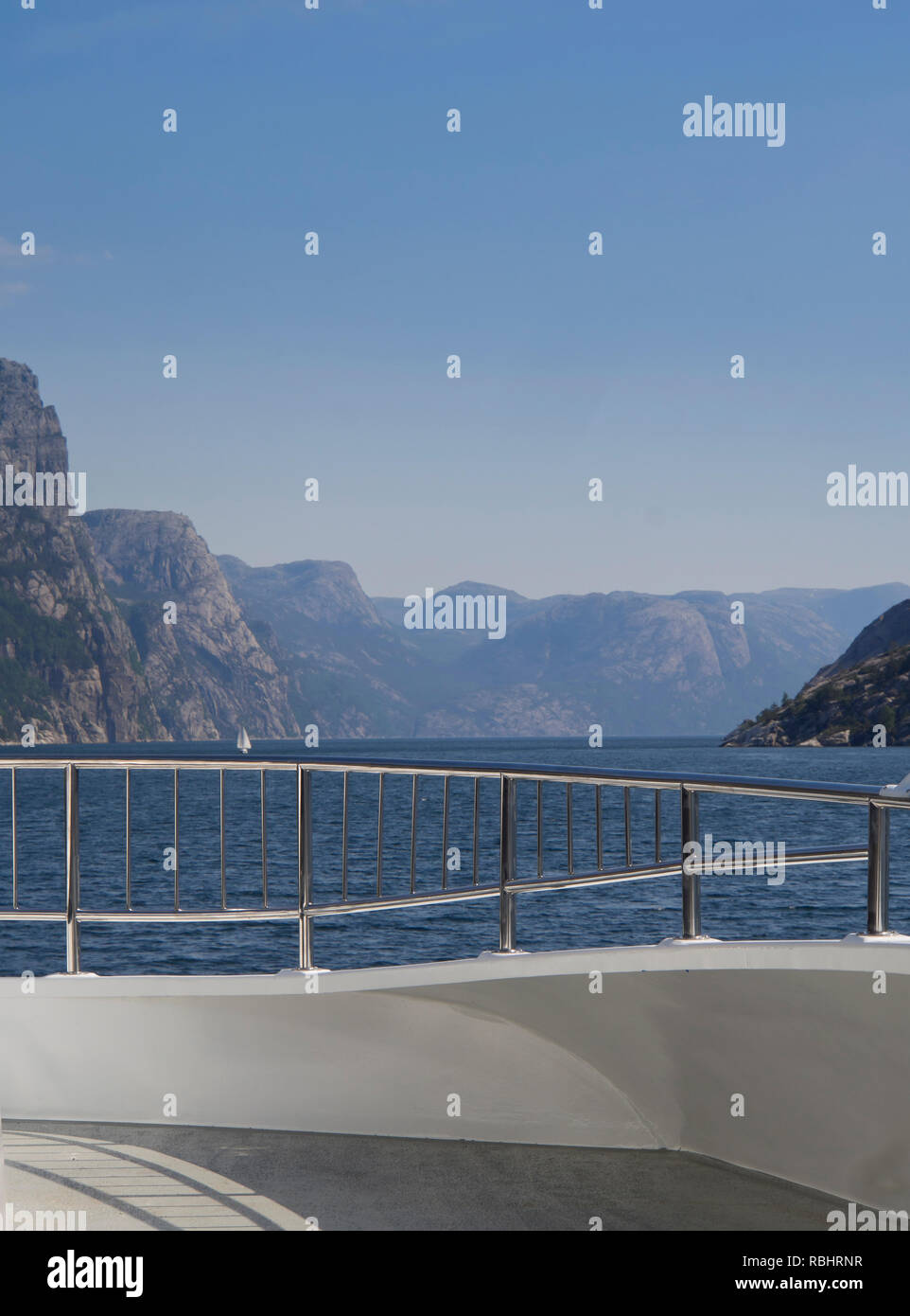 A one day fjord cruise in Lysefjorden east of Stavanger Norway, spectacular views of steep mountainsides from the front deck - Stock Image