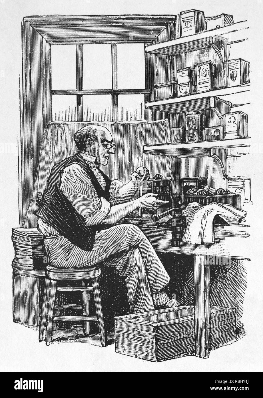 Artisan in his workshop. Engraving. 19th century. - Stock Image