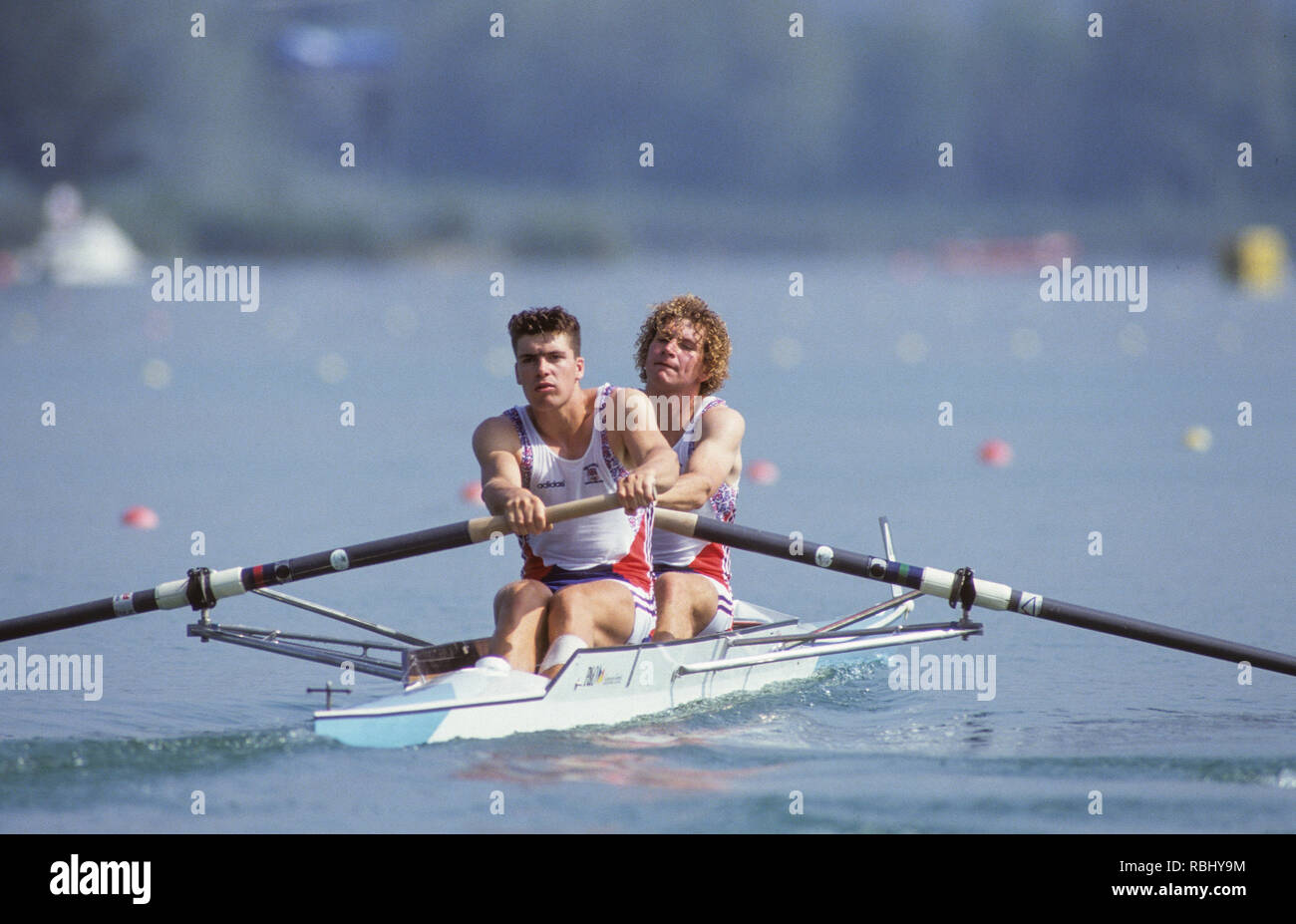 Barcelona, SPAIN. Gold Medalist, GBR M2+, Bow Jonny SEARLE and Greg SEARLE with cox, Gary HERBERT.  Celebrate on the awards dock. 1992 Olympic Rowing Regatta Lake Banyoles, Catalonia [Mandatory Credit Peter Spurrier/ Intersport Images] Last time Men's coxed pair raced at the Olympics, Stock Photo