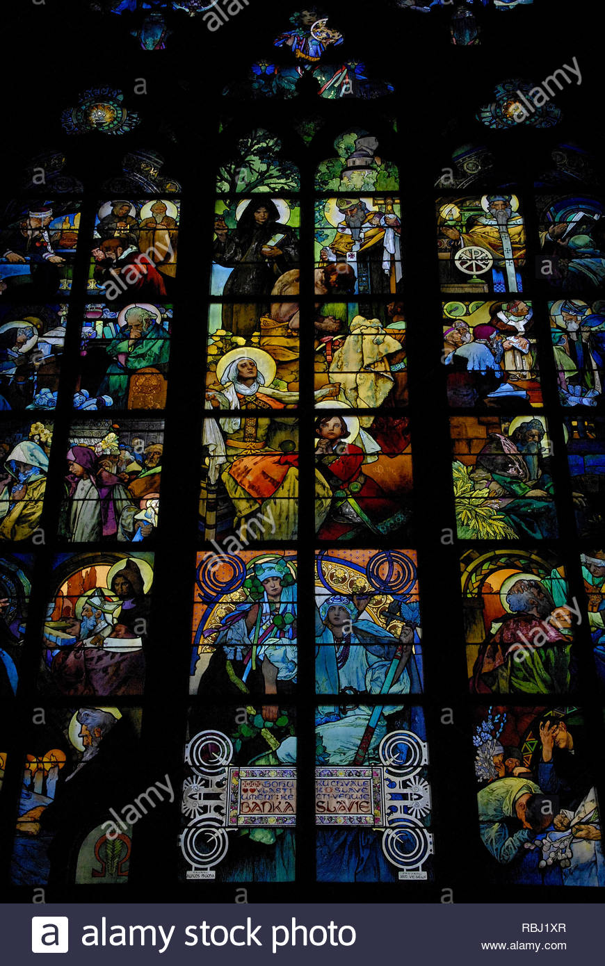 Prague, Czech Republic: Art Nouveau window in Cathedral of St. Vitus, The Lives of SS. Cyril & Methodius by Moravian artist Alfons Mucha (1860-1939). - Stock Image