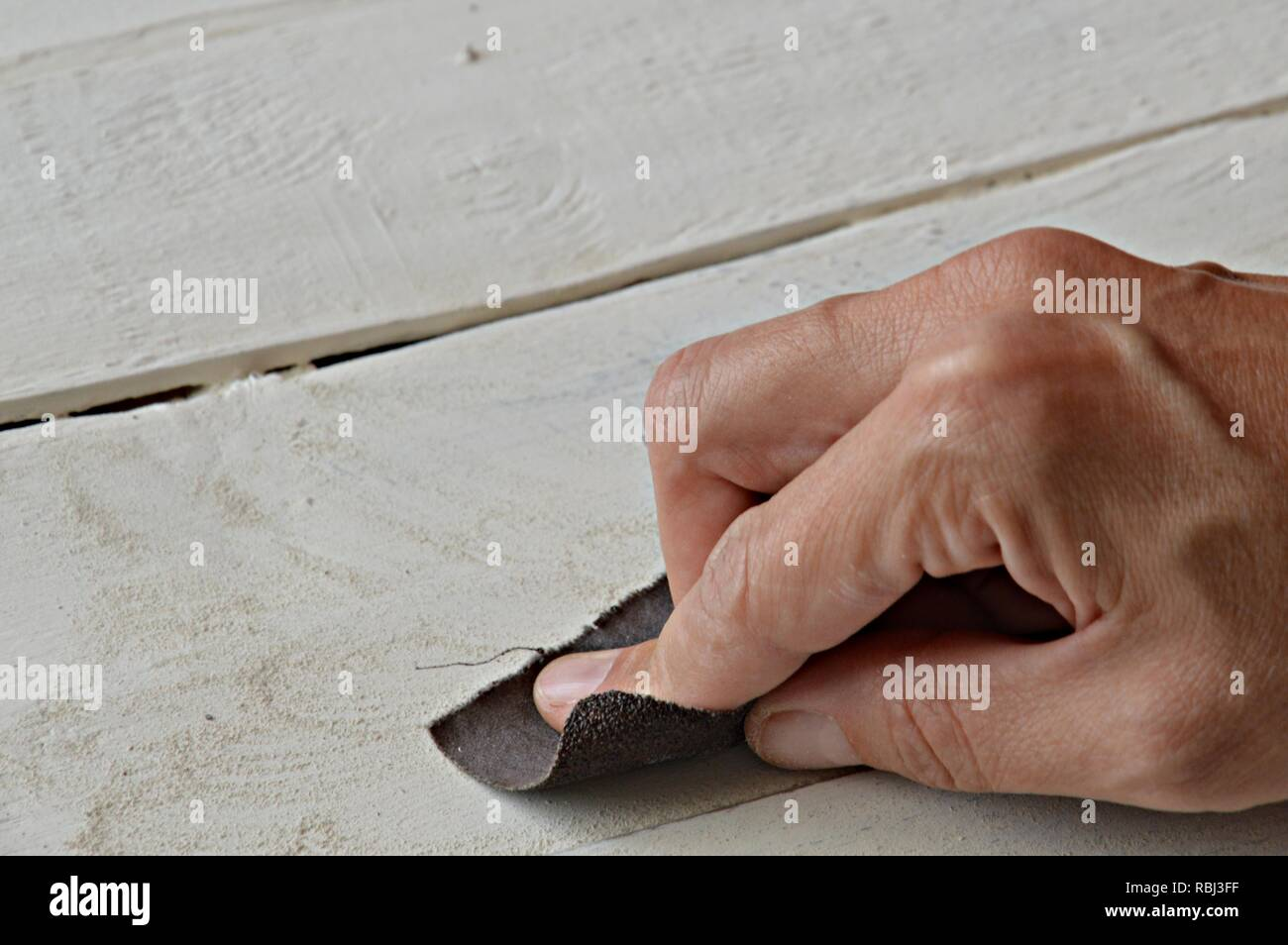 do it yourself, working on a white painted wooden board - Stock Image
