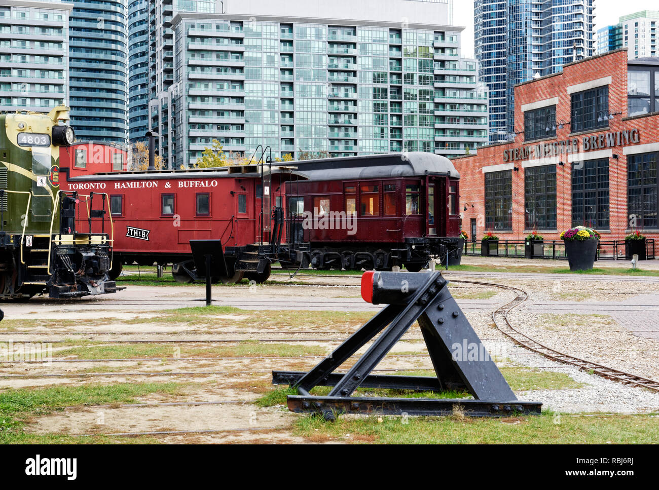 Trains from the Toronto Railway Museum and the Steam Whistle Brewing building, Toronto, Canada - Stock Image