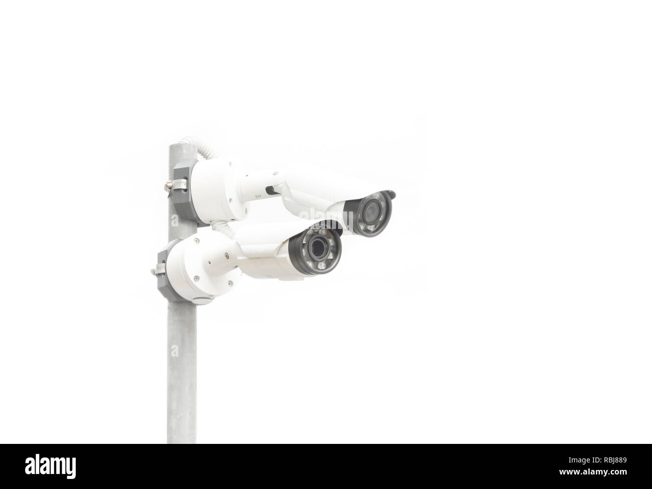 two surveillance camera isolated on white background, copy space - Stock Image