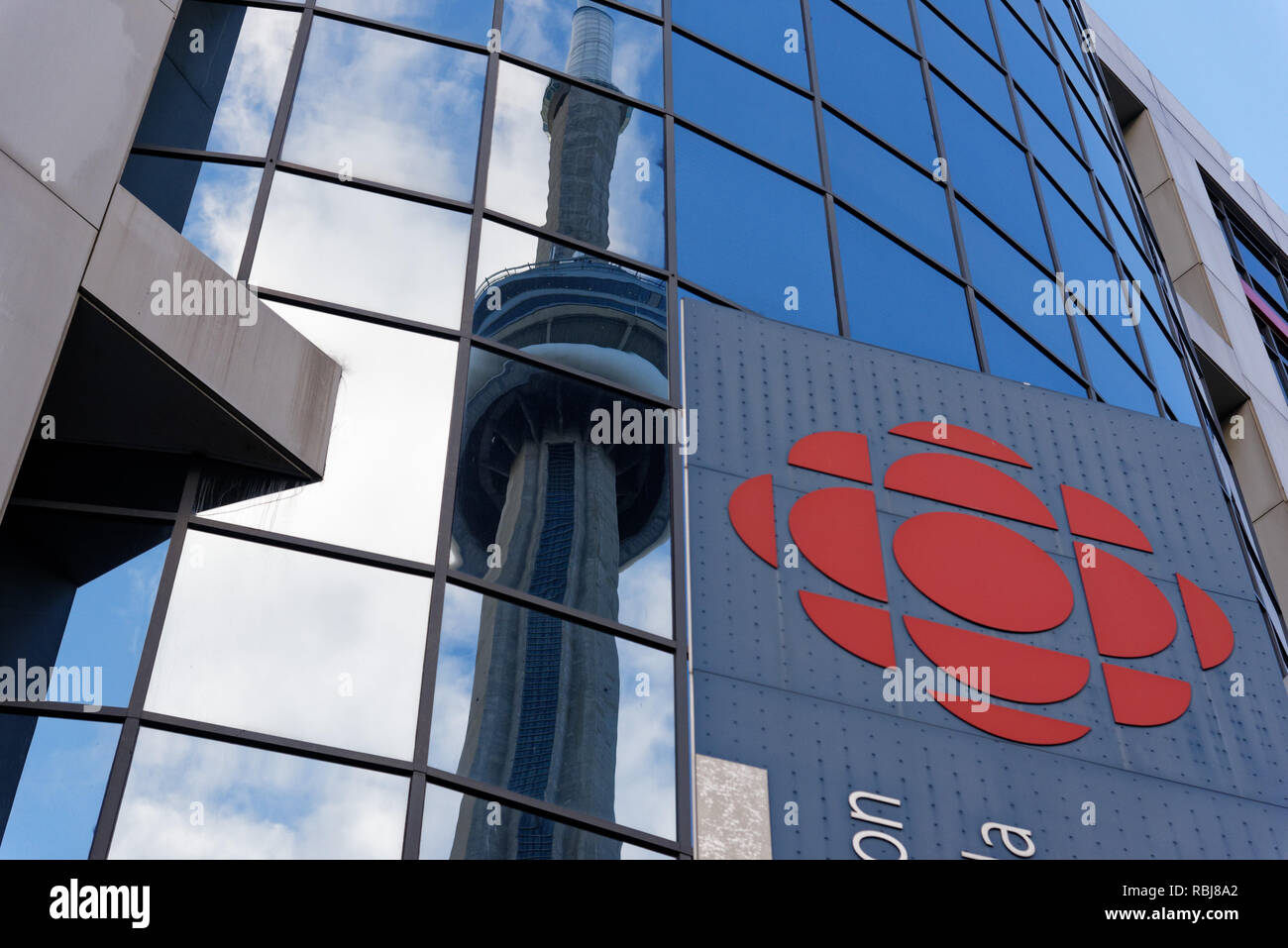 The CN Tower reflected in the windows of the Canadian Broadcasting Corporation (CBC) building. - Stock Image