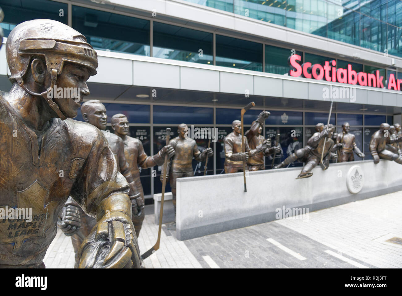 Life size sculpture of hockey players on Maple Leaf Square outside the Scotiabank Arena in Toronto, Canada - Stock Image