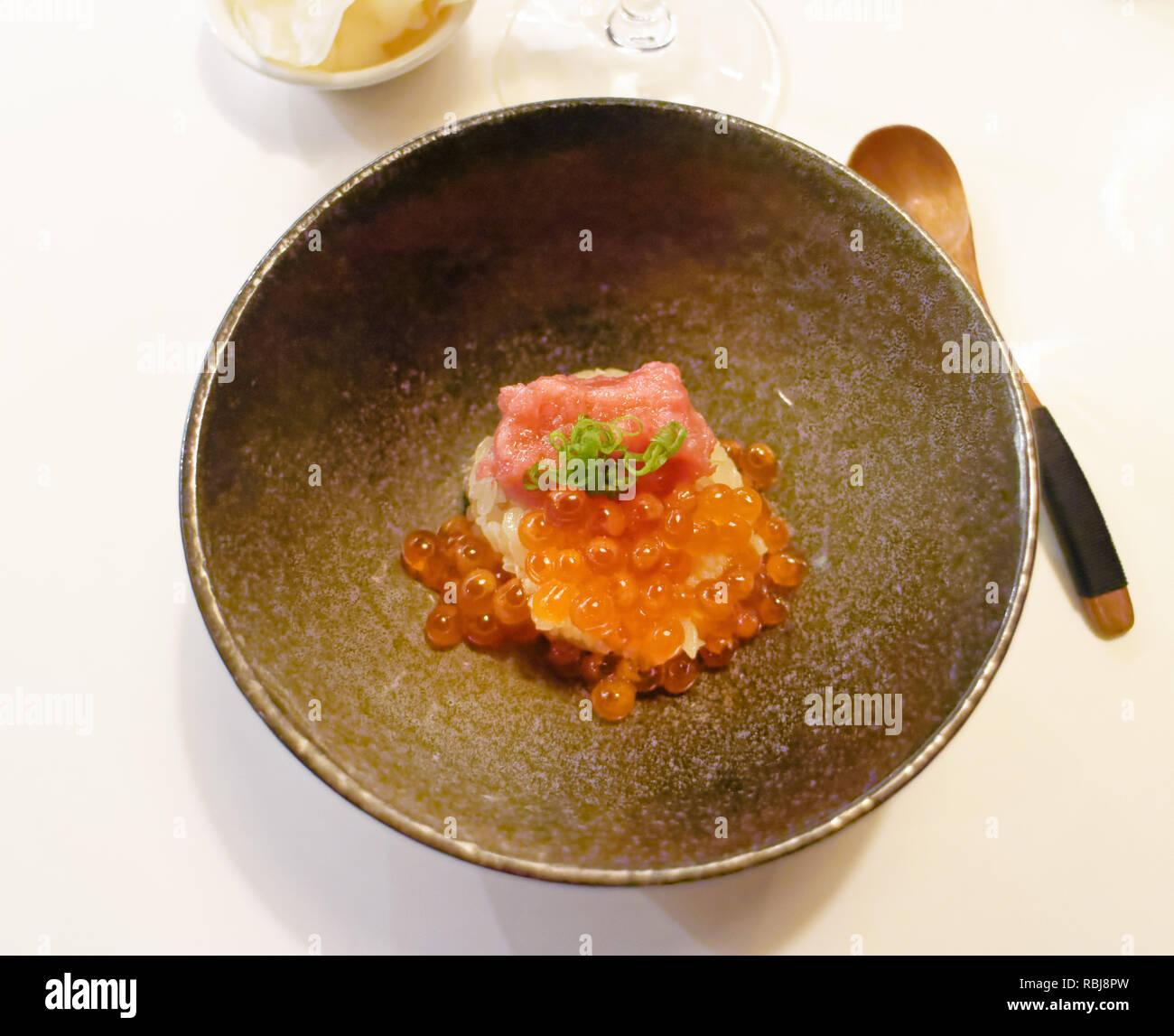 A bowl of fatty tuna and salmon roe sushi in Yasu Omakase Sushi Bar in Toronto, Canada - Stock Image