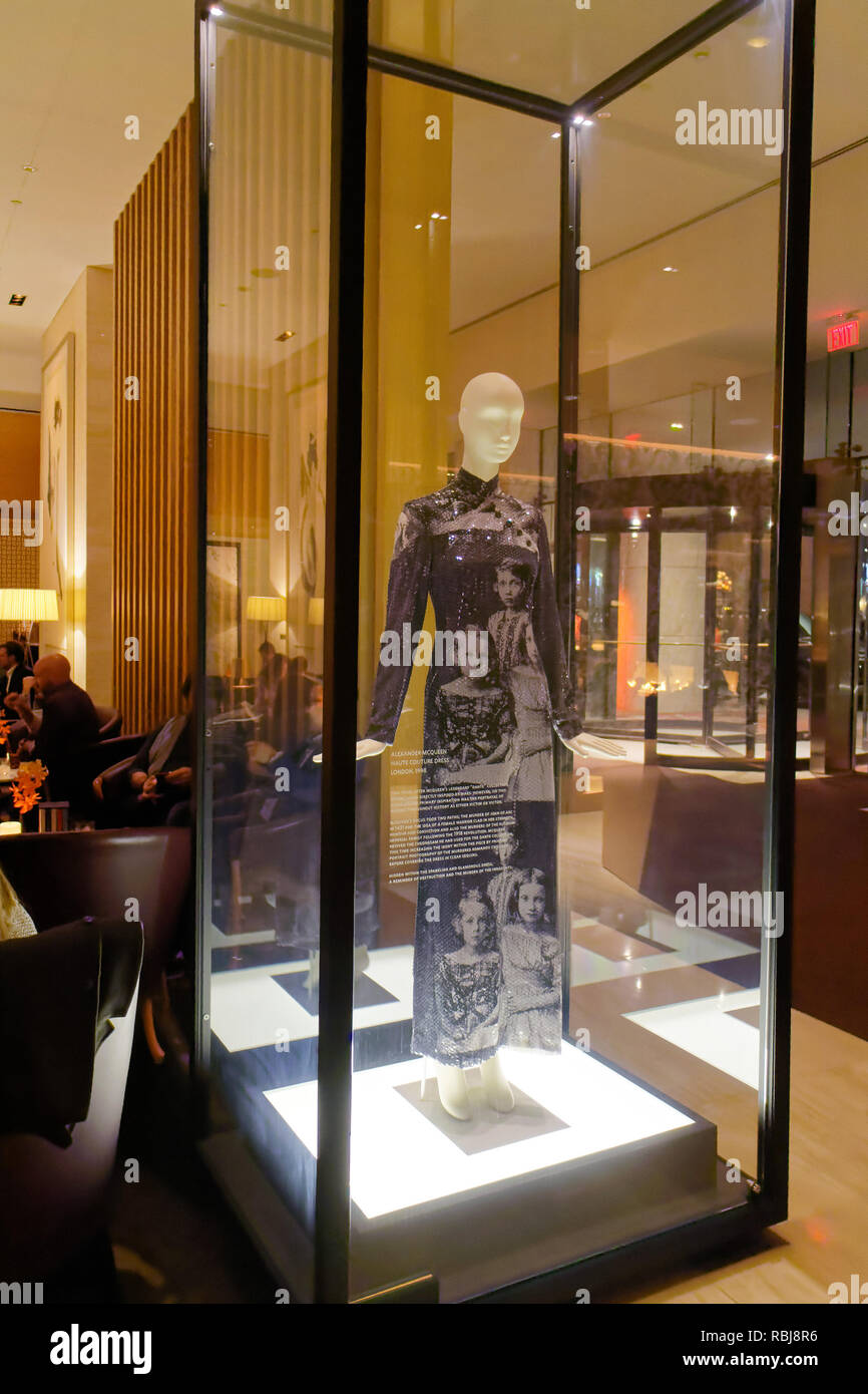 The Haute Couture Dress by Alexander McQueen designer dress in a glass case inside The Bar of the Shangri La hotel in Toronto, Canada - Stock Image