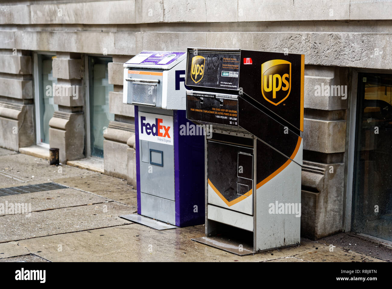 A FedEx and a UPS postage box in Toronto - Stock Image