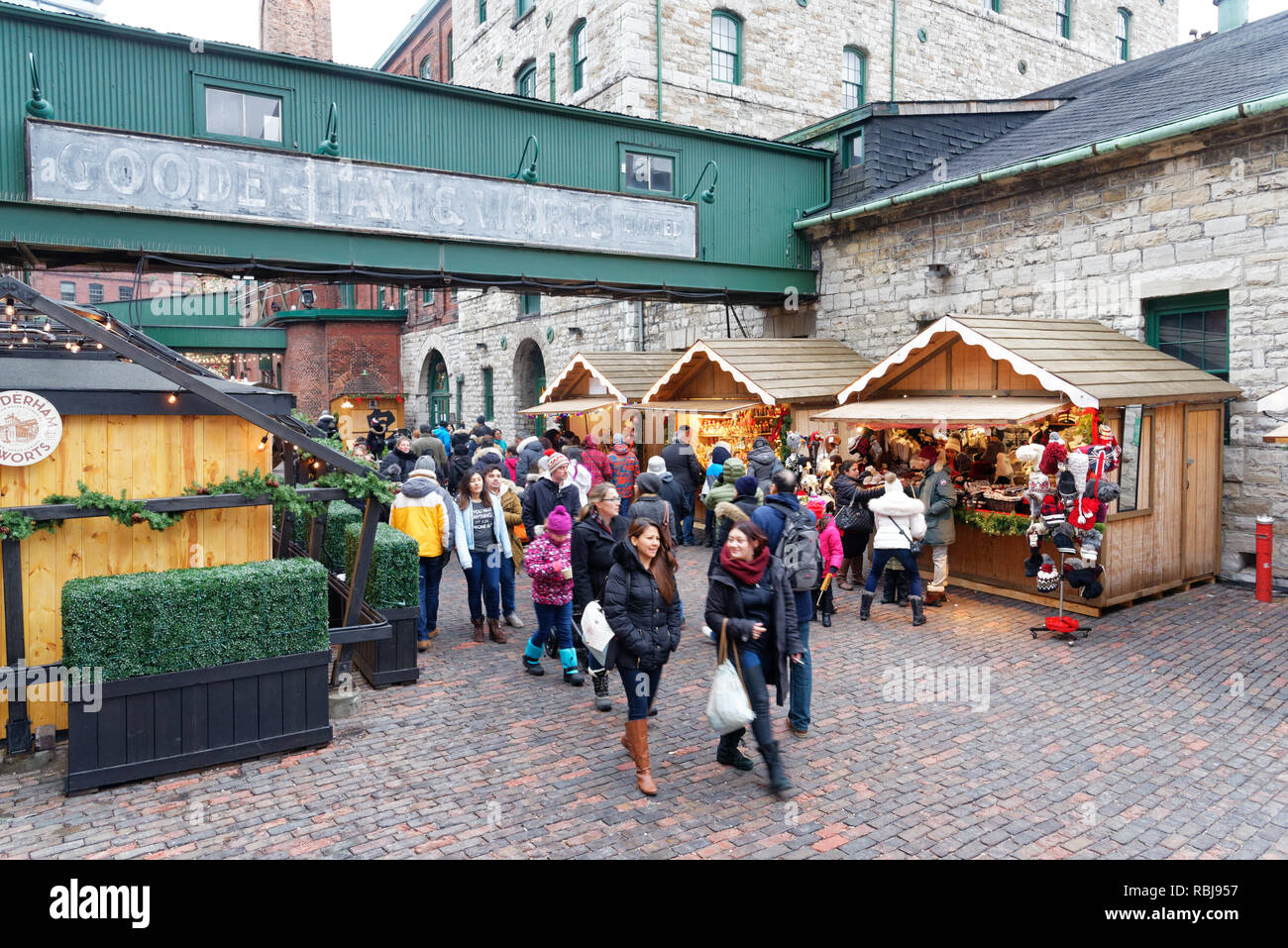 People walking in Toronto Christmas Market in The Distillery District - Stock Image