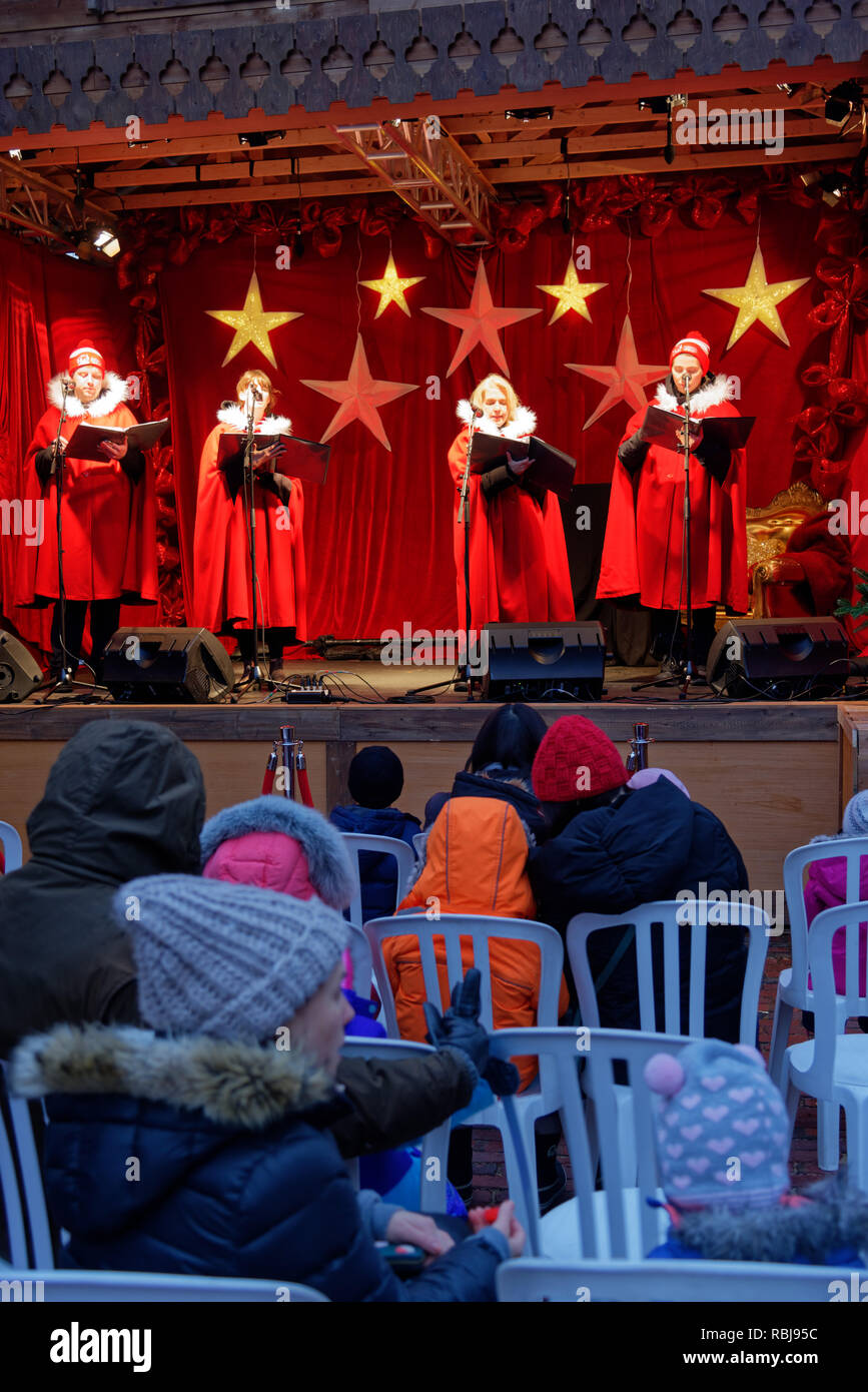 Carol Singers in Toronto Christmas Market in the Distillery District - Stock Image