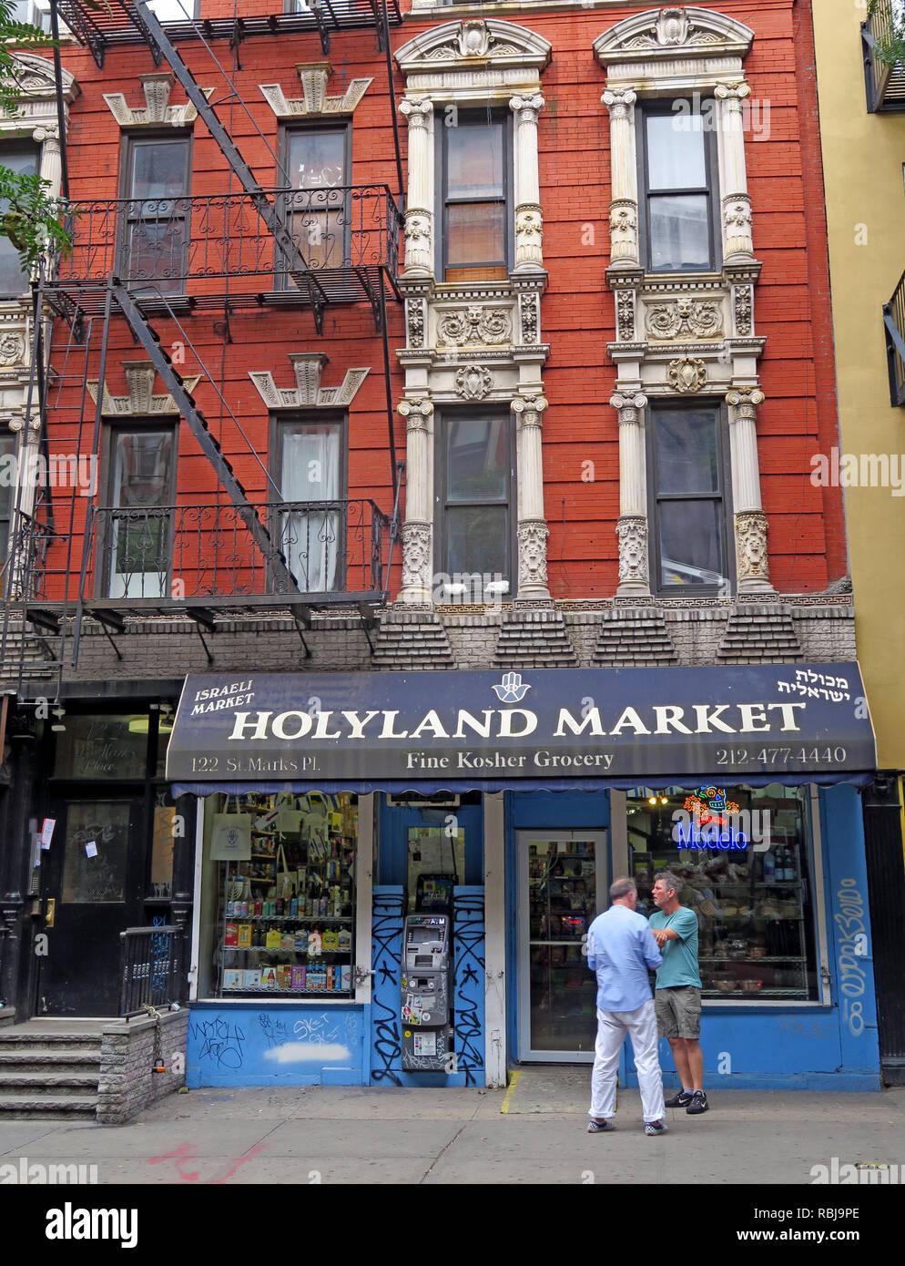 Two men outside Holyland Market, 122 St Marks Place, East Village, New York, NYC, NY, USA Stock Photo