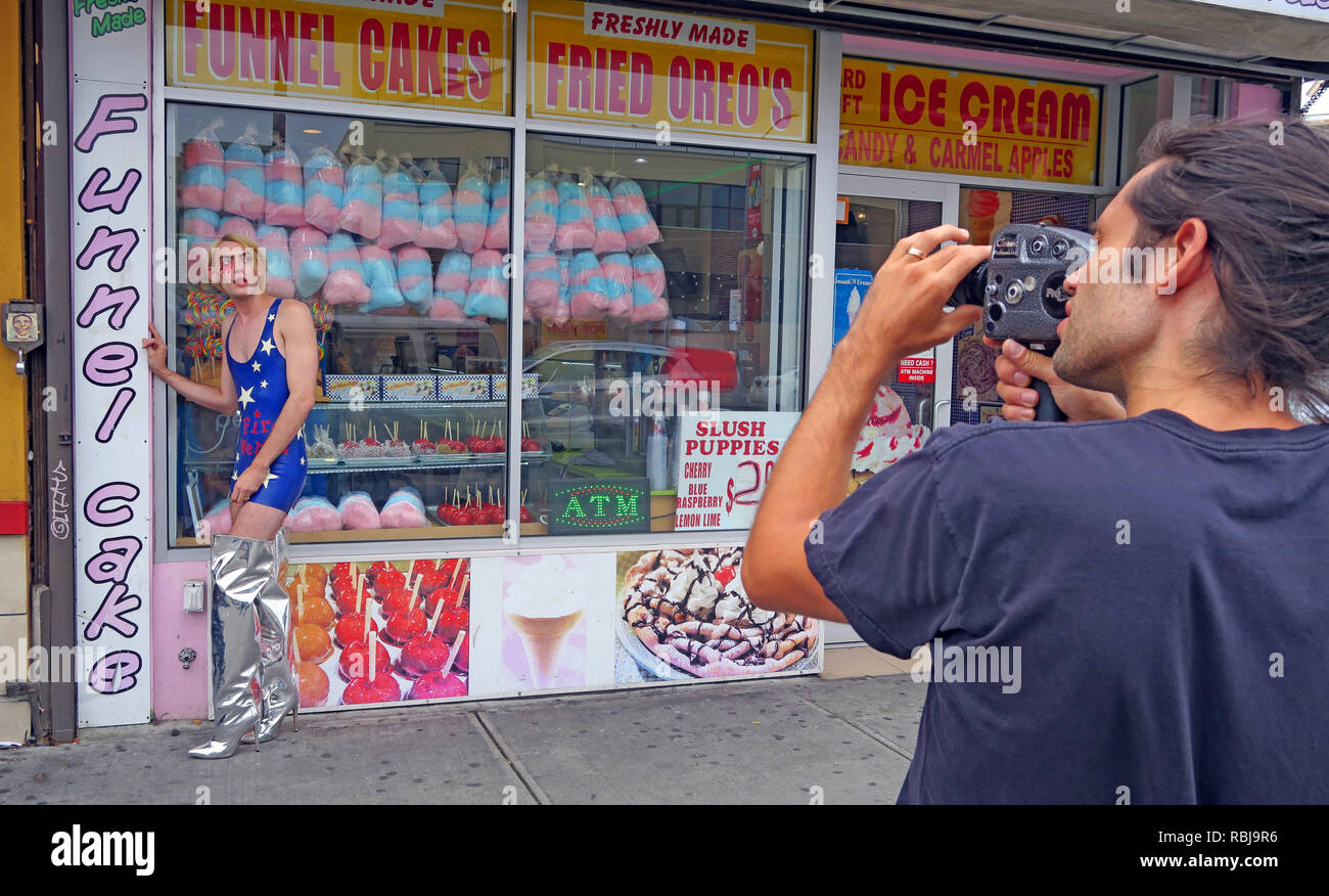 Filming a movie on 8mm camera, Coney Island, Brooklyn, New York, NYC, USA - Stock Image