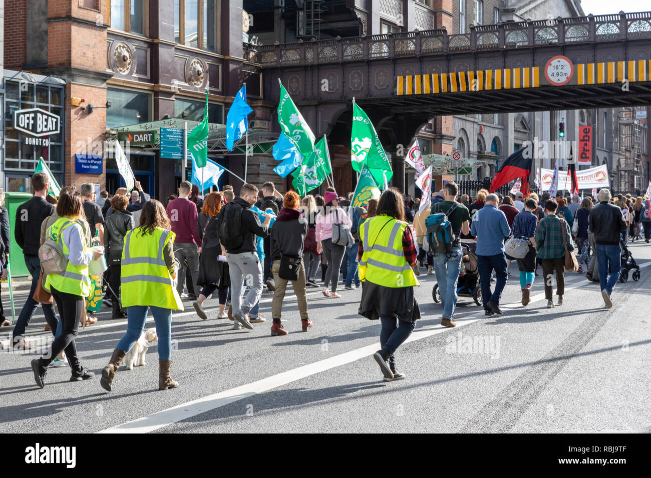 Political protesters marching in the vicinity of Pearse Station in Dublin, Ireland. - Stock Image