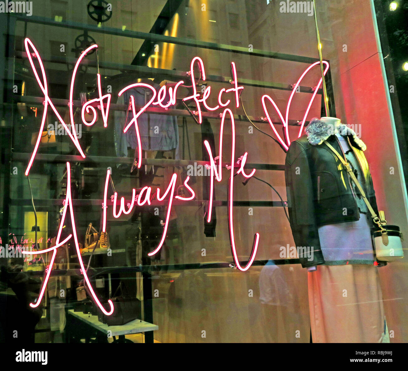 Not Perfect Always Me sign, Selena Gomez collection, In A Coach Store, New York City, NY, USA - Stock Image