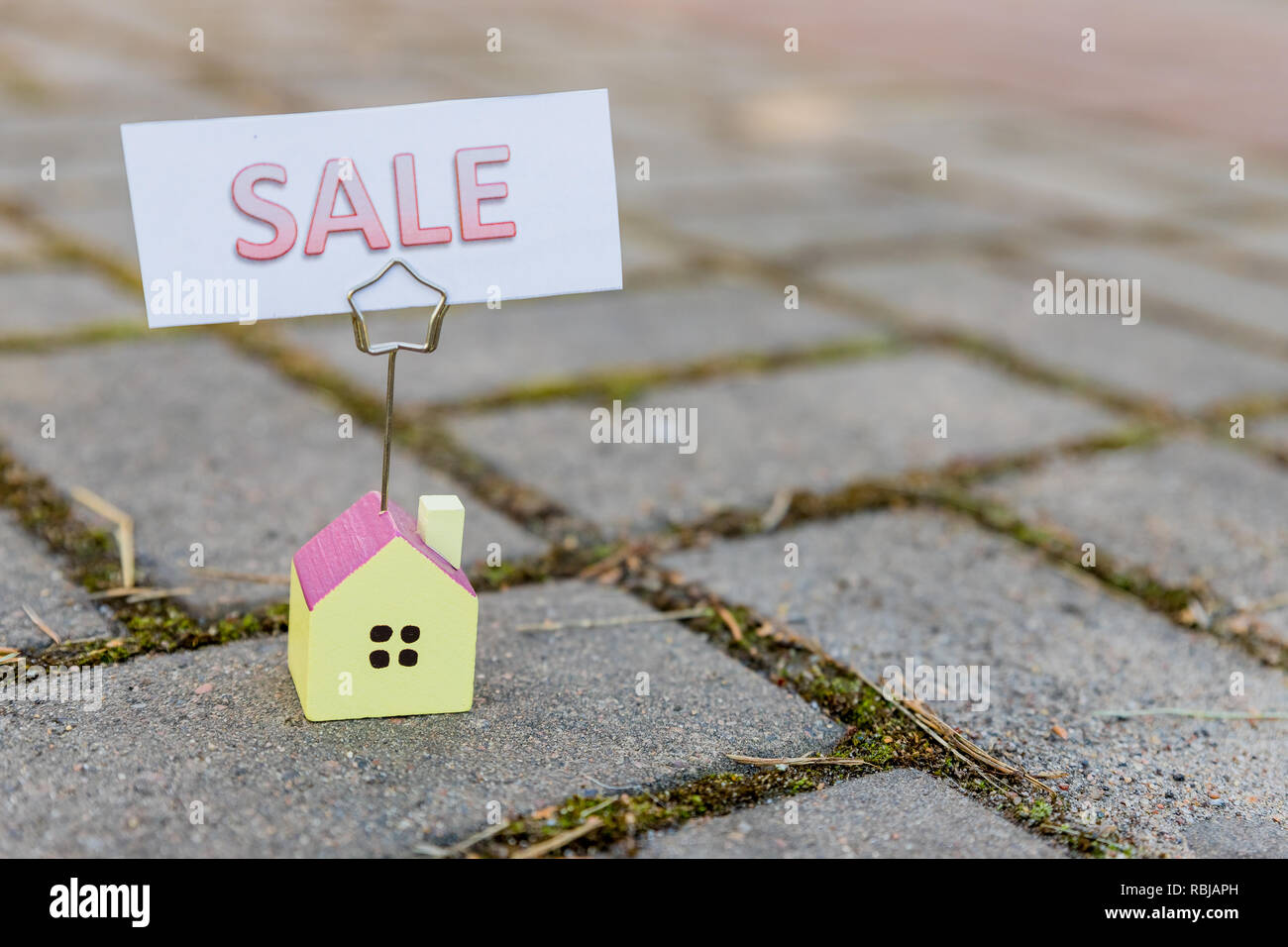 Home For Sale Real Estate Sign and Beautiful New House.For sale sign. sale board In Front Yard .loans, Bank debt, financial problems, the issue of new housing concept.Copy space - Stock Image