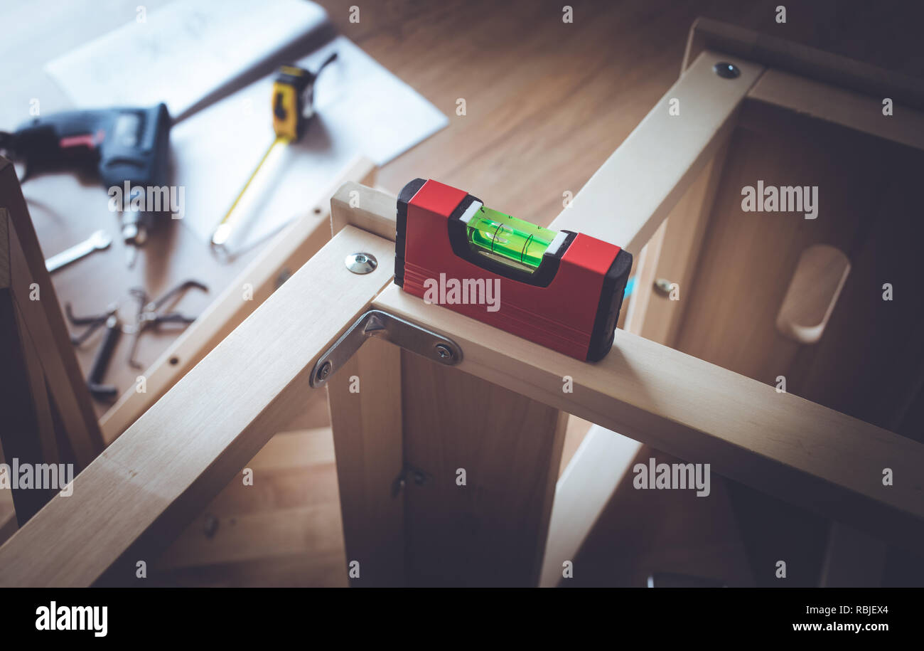 LEVELS tool on wooden furniture in workplace.craftsman diy concepts ideas - Stock Image