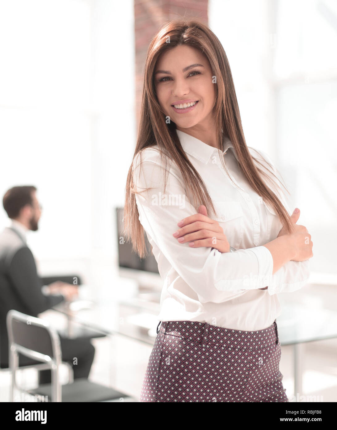 young confident business woman on the background of the office - Stock Image
