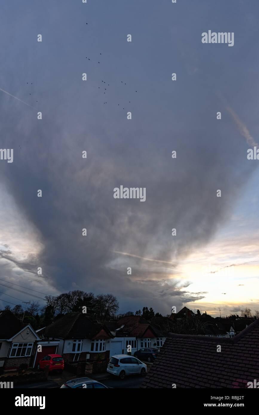 Dark rising storm clouds over suburban landscape Shepperton Surrey England UK - Stock Image