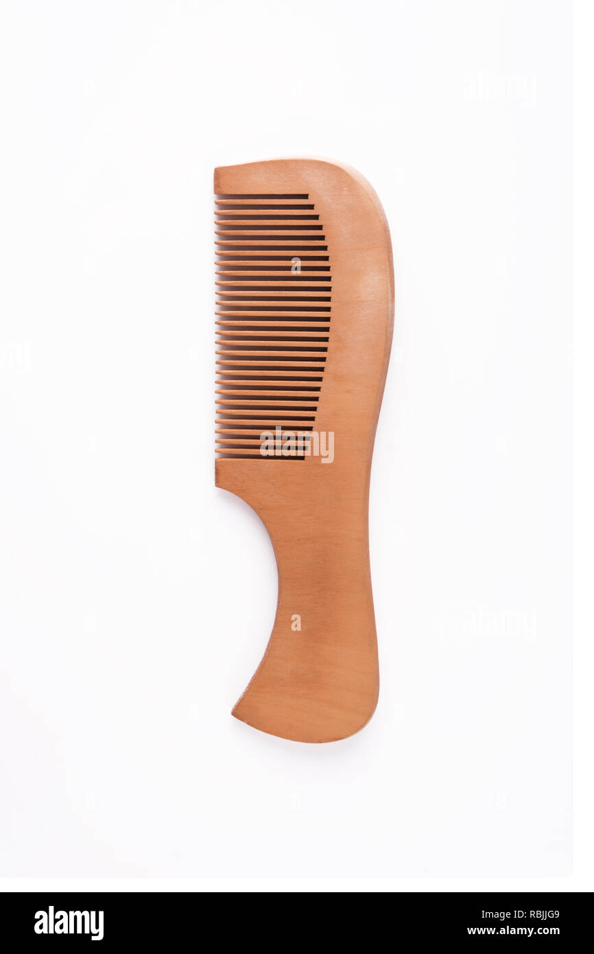 Natural wood comb isolated on white background - Stock Image