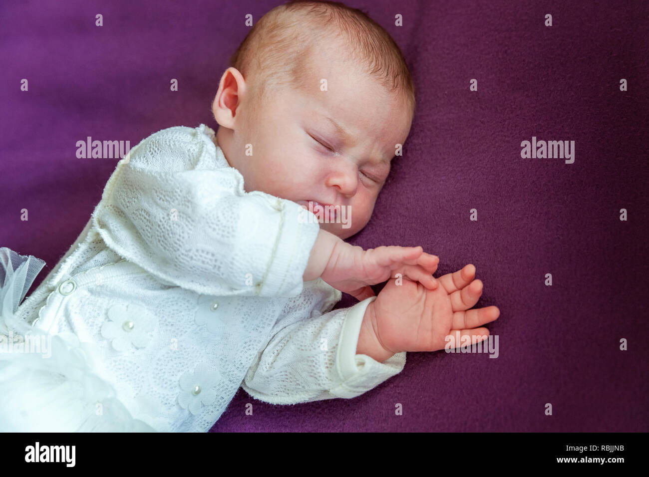 Soft Portrait Of Peaceful Sweet Newborn Infant Baby Lying On Bed While Sleeping In Purple Blanket Background Sweet Dream Good Night Maternity Famil Stock Photo Alamy