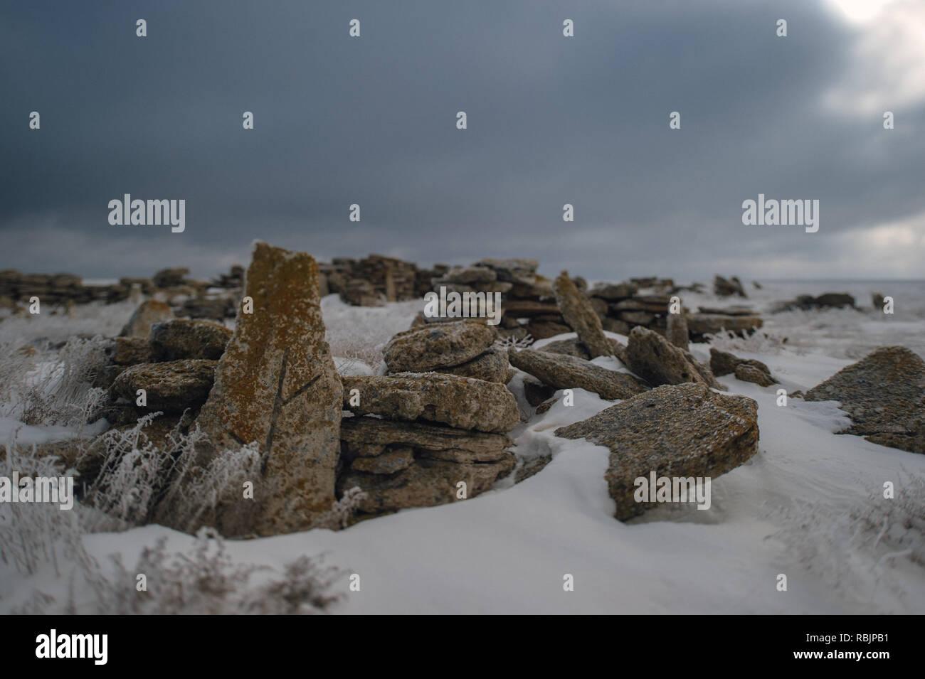 Gravesites left by nomadic Kazakhs on the desolate Ustyurt Plateau near the Uzbekistan Kazakhstan border. - Stock Image