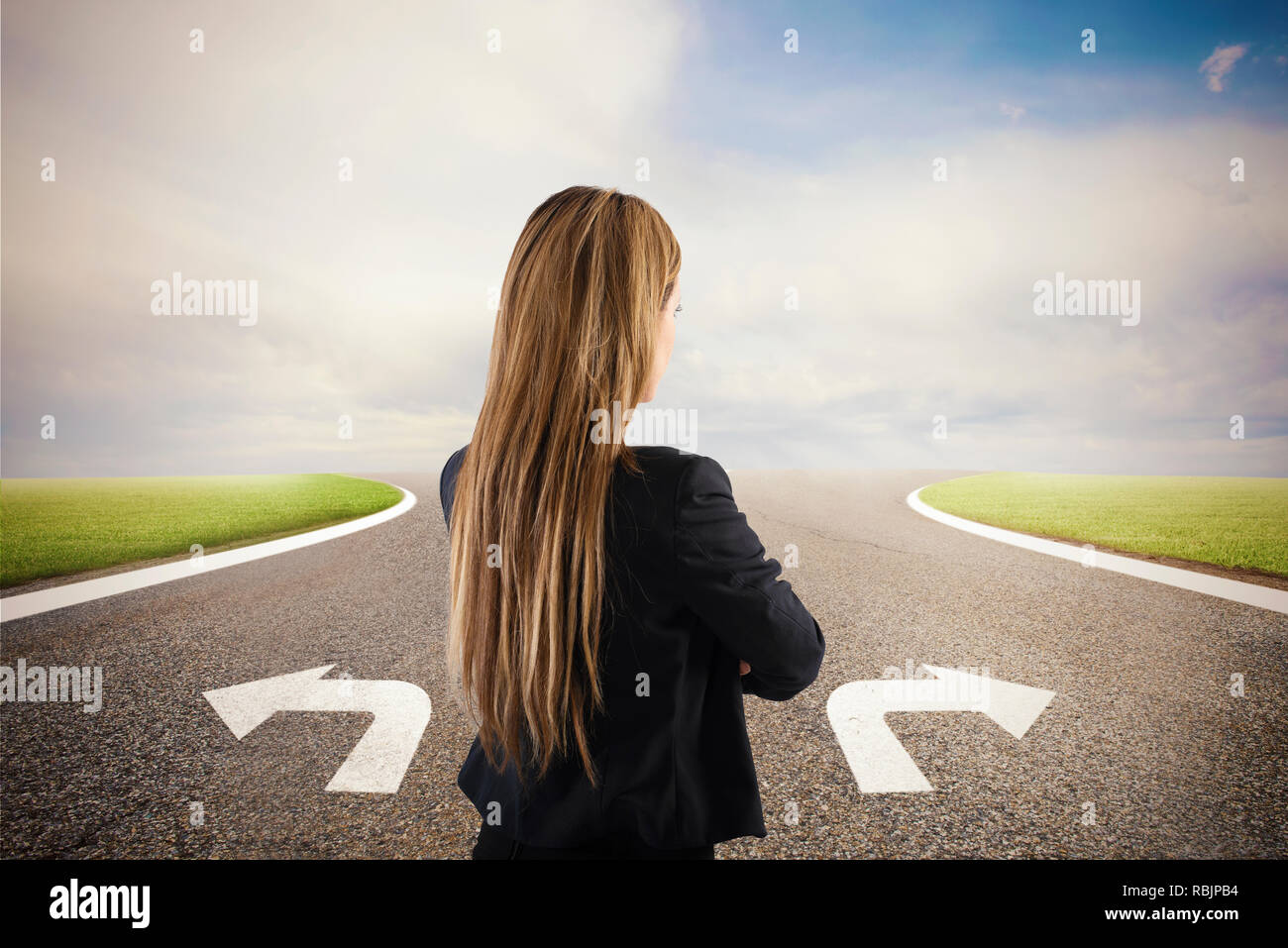 Businesswoman at a crossroads. She chooses the correct way. Concept of decision in business - Stock Image