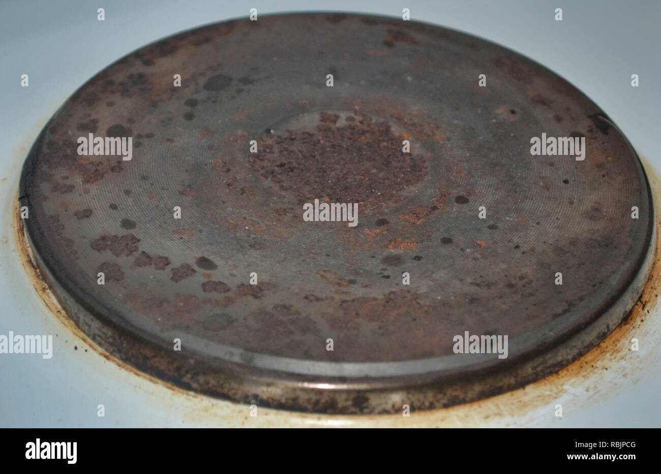 old rusty stove top - Stock Image