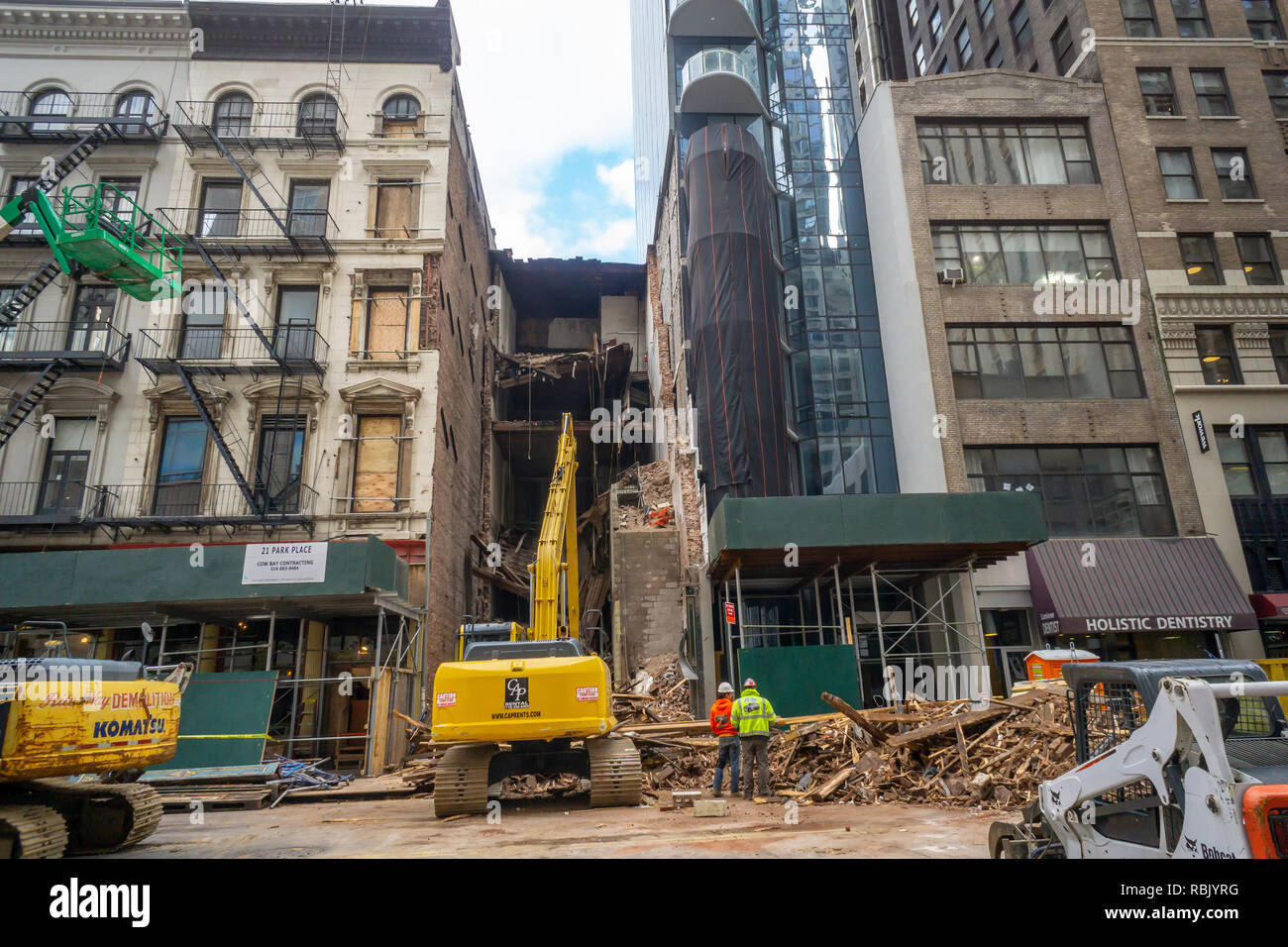 Demolition of 21 Park Place in Lower Manhattan in New York next to a