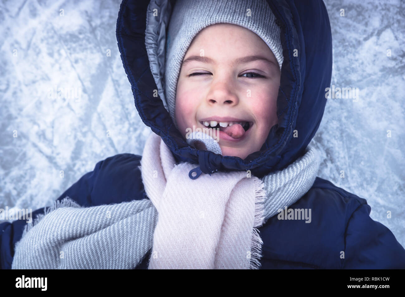 6ebfee84f Winter cheerful child portrait on snow ice background having fun on ...