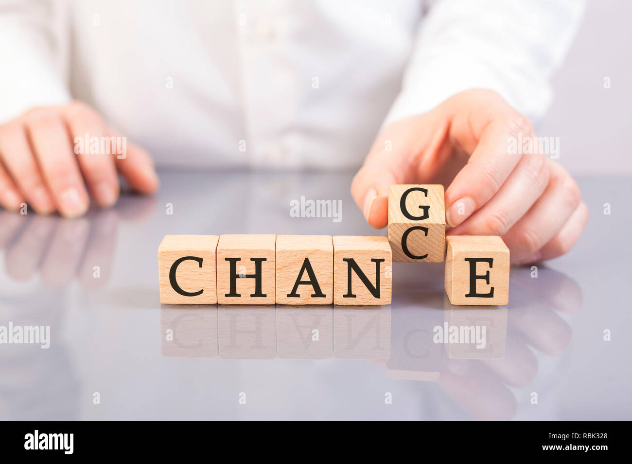 hand flip chance word to change word with wooden cubes - Stock Image