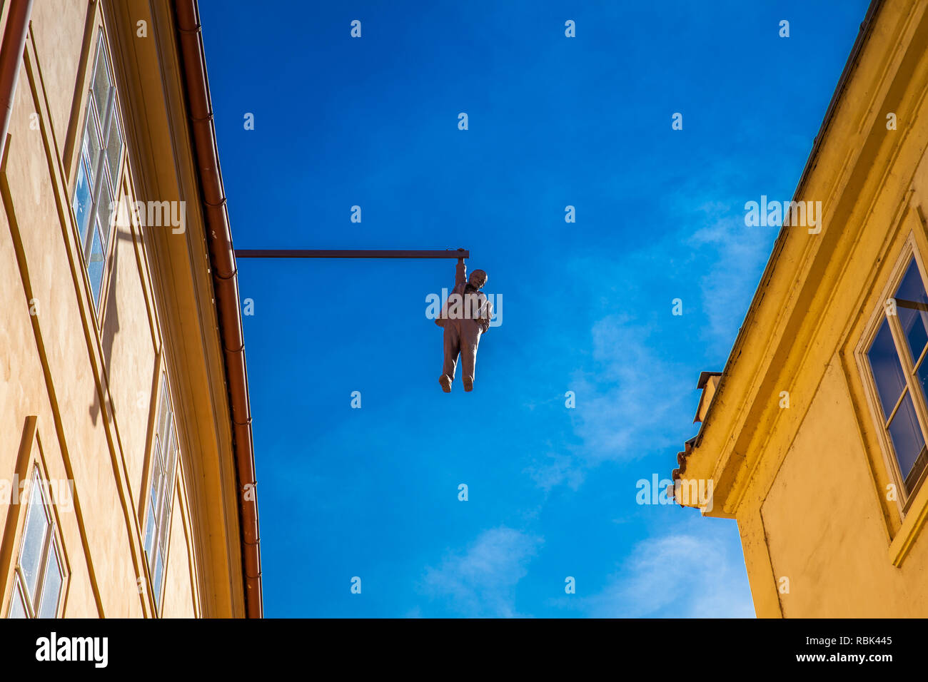 PRAGUE, CZECH REPUBLIC - APRIL, 2018: Sculpture of the psychoanalyst Sigmund Freud hanging by a hand called Man Hanging Out created by the artist Davi - Stock Image