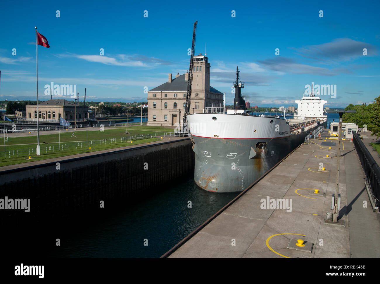 Sault Ste Marie, Michigan. The bulk carrier Kaministiqua going through the Soo Locks on the St. Mary's river heading out to Lake Superior to pickup a  - Stock Image
